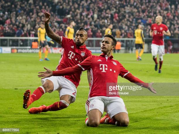 Thiago Alcantara of FC Bayern Muenchen celebrates with team mate Arturo Vidal after scoring his team's fourth goal during the UEFA Champions League...