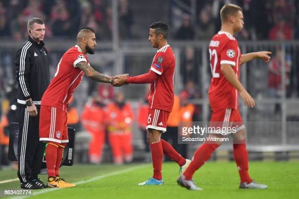 Thiago Alcantara of FC Bayern Muenchen is being substituted by Arturo Vidal during the UEFA Champions League group B match between Bayern Muenchen...