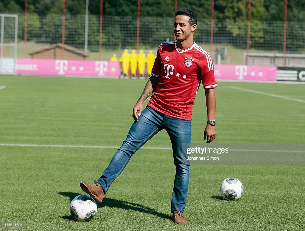 Thiago Alcantara of FC Bayern Muenchen plays with a ball after a press conference at Bayern Muenchens headquarter Saebener Strasse on July 16, 2013 in Munich, Germany.