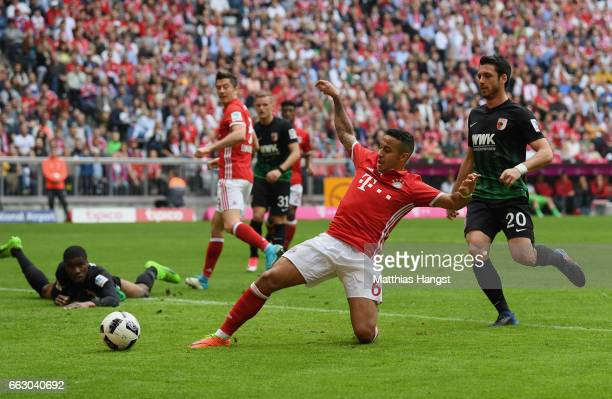Thiago Alcantara of FC Bayern Muenchen scores his team's fourth goal during the Bundesliga match between Bayern Muenchen and FC Augsburg at Allianz...