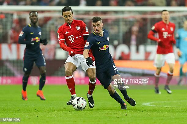 Thiago Alcantara of Muenchen and Diego Demme of Leipzig battle for the ball during the Bundesliga match between Bayern Muenchen and RB Leipzig at...