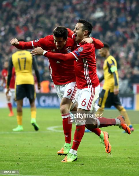 Thiago Alcantara of Muenchen celebrate with team mates Robert Lewandowski the 3rd goal during the UEFA Champions League Round of 16 first leg match...