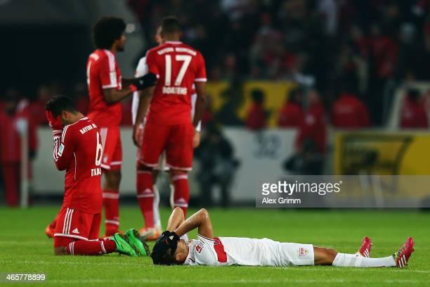 Thiago Alcantara of Muenchen celebrates as Moritz Leitner of Stuttgart reacts after the Bundesliga match between VfB Stuttgart and FC Bayern Muenchen...