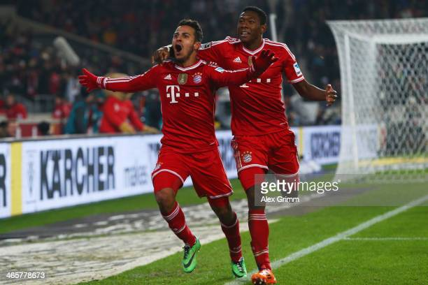 Thiago Alcantara of Muenchen celebrates his team's second goal with team mate David Alaba during the Bundesliga match between VfB Stuttgart and FC...