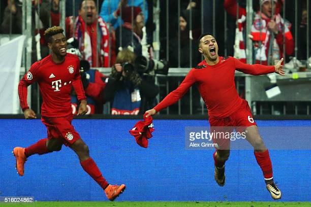 Thiago Alcantara of Muenchen celebrates his team's third goal with team mate Kingsley Coman during the UEFA Champions League Round of 16 Second Leg...