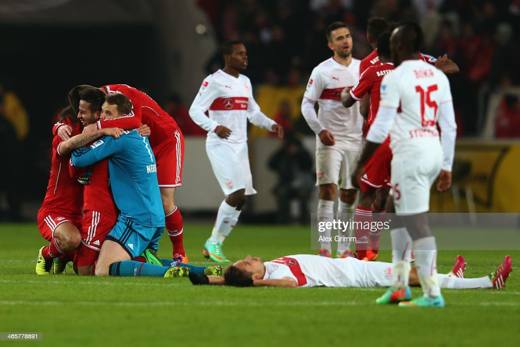 Thiago Alcantara of Muenchen celebrates with team mates <a gi-track='captionPersonalityLinkClicked' href=/galleries/search?phrase=Claudio+Pizarro&family=editorial&specificpeople=217807 ng-click='$event.stopPropagation()'>Claudio Pizarro</a> and goalkeeper <a gi-track='captionPersonalityLinkClicked' href=/galleries/search?phrase=Manuel+Neuer&family=editorial&specificpeople=764621 ng-click='$event.stopPropagation()'>Manuel Neuer</a> as players of Stuttgart react after the Bundesliga match between VfB Stuttgart and FC Bayern Muenchen at Mercedes-Benz Arena on January 29, 2014 in Stuttgart, Germany.