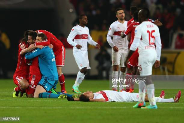 Thiago Alcantara of Muenchen celebrates with team mates Claudio Pizarro and goalkeeper Manuel Neuer as players of Stuttgart react after the...