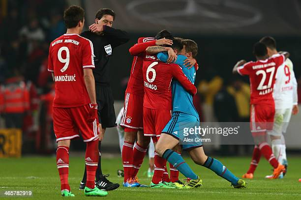 Thiago Alcantara of Muenchen celebrates with team mates Claudio Pizarro and goalkeeper Manuel Neuer after the Bundesliga match between VfB Stuttgart...
