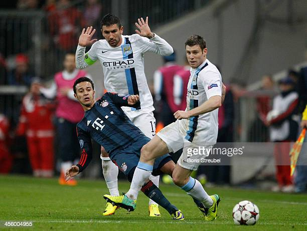 Thiago Alcantara of Muenchen fights for the ball with Aleksandar Kolarov and James Milner of Manchester during the UEFA Champions League Group D...