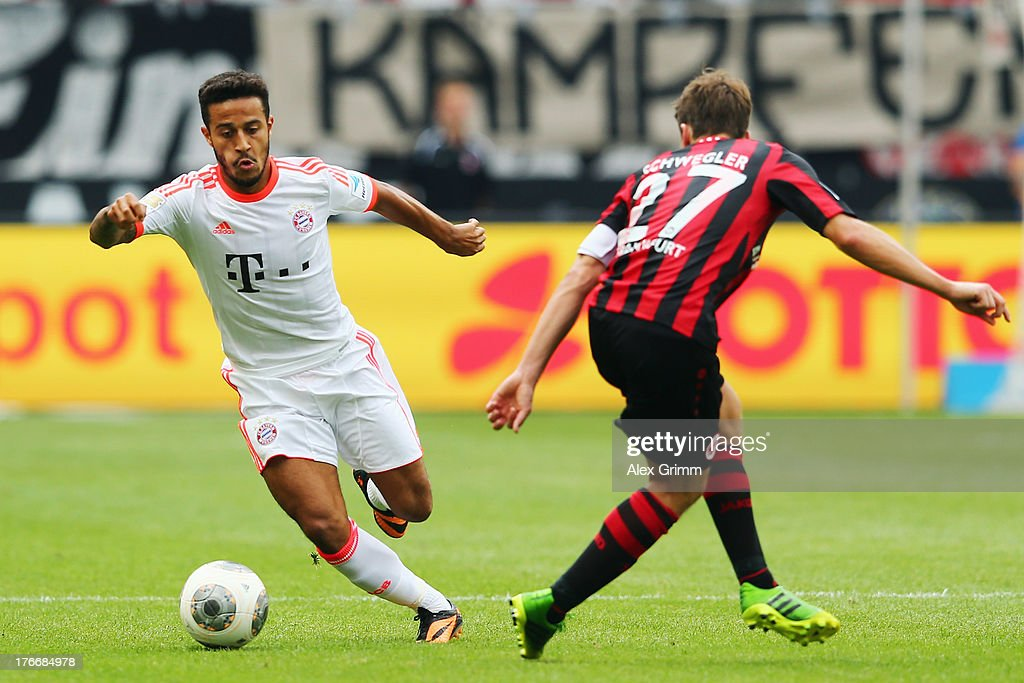 Thiago Alcantara (L) of Muenchen is challenged by <a gi-track='captionPersonalityLinkClicked' href=/galleries/search?phrase=Pirmin+Schwegler&family=editorial&specificpeople=604263 ng-click='$event.stopPropagation()'>Pirmin Schwegler</a> of Frankfurt during the Bundesliga match between Eintracht Frankfurt and FC Bayern Muenchen at Commerzbank Arena on August 17, 2013 in Frankfurt am Main, Germany.