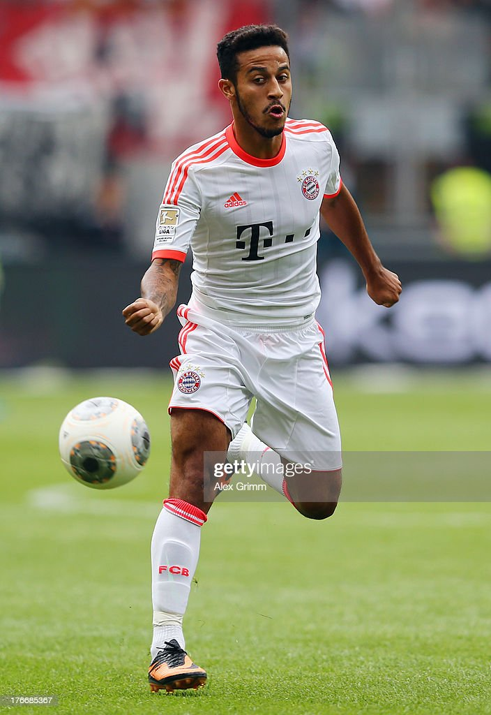 Thiago Alcantara of Muenchen passes the ball during the Bundesliga match between Eintracht Frankfurt and FC Bayern Muenchen at Commerzbank Arena on August 17, 2013 in Frankfurt am Main, Germany.