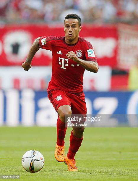 Thiago Alcantara of Muenchen runs with the ball during the Bundesliga match between FC Bayern Muenchen and Bayer 04 Leverkusen at Allianz Arena on...