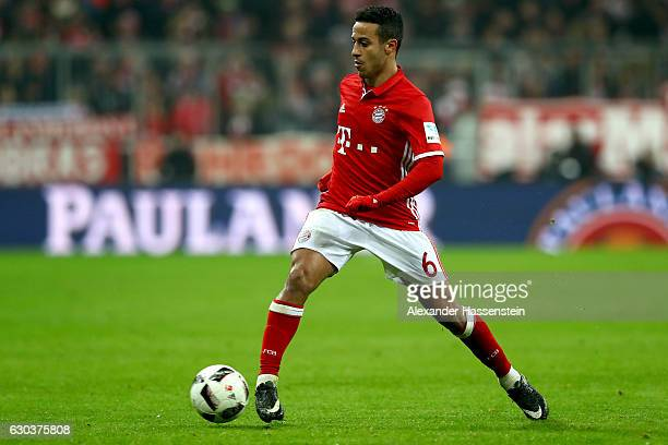Thiago Alcantara of Muenchen runs with the ball during the Bundesliga match between Bayern Muenchen and RB Leipzig at Allianz Arena on December 21...