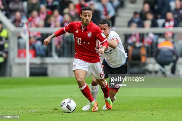 Thiago Alcantara of Munich and Robin Kwamina Quaison of Mainz battle for the ball during the Bundesliga match between Bayern Muenchen and 1 FSV Mainz...