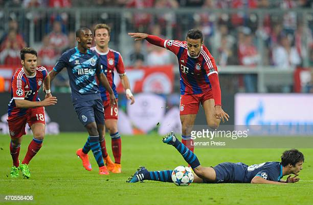 Thiago Alcantara of Munich challenges Oliver Torres of Porto during the UEFA Champions League quarter final second leg match between FC Bayern...