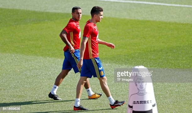 Thiago Alcantara of Spain and Marc Bartra of Spain looks on during a training session on August 30 2017 in Madrid Spain