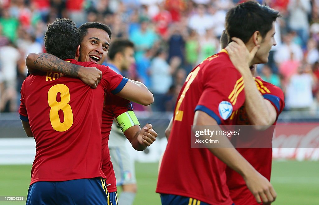 Thiago Alcantara (2L) of Spain celebrates his team's first goal with team mates during the UEFA European U21 Championship final match between Italy and Spain at Teddy Stadium on June 18, 2013 in Jerusalem, Israel.