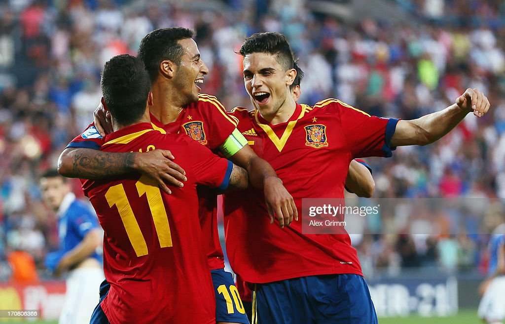Thiago Alcantara (C) of Spain celebrates his team's third goal with team mates <a gi-track='captionPersonalityLinkClicked' href=/galleries/search?phrase=Cristian+Tello&family=editorial&specificpeople=8014696 ng-click='$event.stopPropagation()'>Cristian Tello</a> (front) and <a gi-track='captionPersonalityLinkClicked' href=/galleries/search?phrase=Alvaro+Morata&family=editorial&specificpeople=6523866 ng-click='$event.stopPropagation()'>Alvaro Morata</a> during the UEFA European U21 Championship final match between Italy and Spain at Teddy Stadium on June 18, 2013 in Jerusalem, Israel.