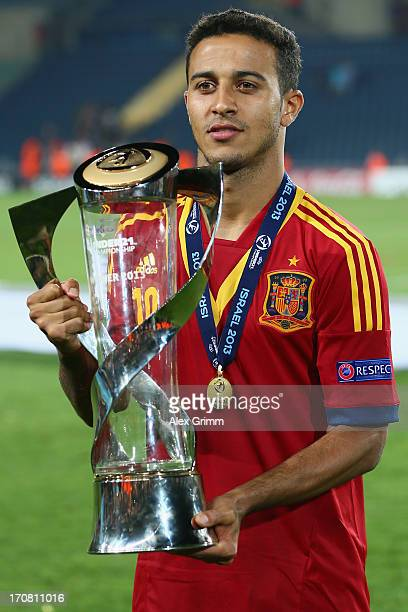 Thiago Alcantara of Spain poses with the trophy after winning the UEFA European U21 Championship final match against Italy at Teddy Stadium on June...