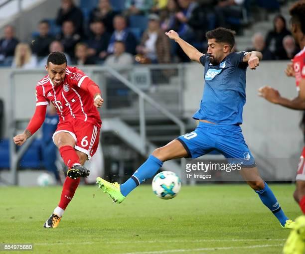 Thiago Alcántara of Muenchen and Kerem Demirbay of Hoffenheim battle for the ball during the Bundesliga match between TSG 1899 Hoffenheim and FC...