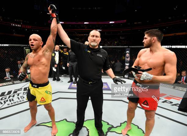 Thiago Alves of Brazil is awarded a unanimous decision victory over Patrick Cote of Canada in their welterweight bout during the UFC 210 event at...