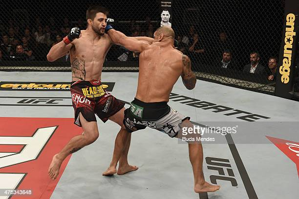 Thiago Alves of Brazil punches Carlos Condit of the United States in their welterweight UFC bout during the UFC Fight Night event at Arena Goiania on...