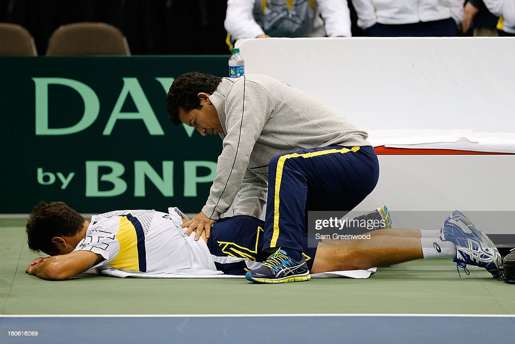 Thiago Alves of Brazil receives treatment during match against Sam Querrey of the United States on day three of the Davis Cup first round between the U.S. and Brazil at Veterans Memorial Arena on February 3, 2013 in Jacksonville, Florida.