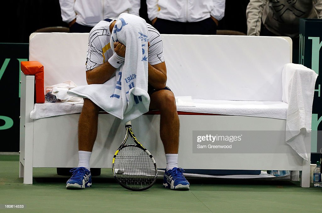 Thiago Alves of Brazil sits on a bench following his loss to Sam Querrey of the United States during day three of the Davis Cup first round match between the U.S. and Brazil at Veterans Memorial Arena on February 3, 2013 in Jacksonville, Florida.