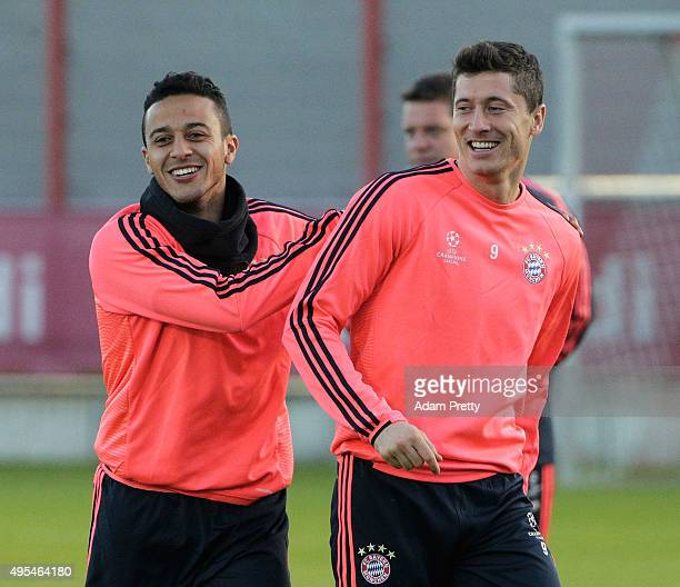 Thiago and Robert Lewandowski of FC Bayern Muenchen in action during the FC Bayern Muenchen training session at the FC Bayern training grounds on...