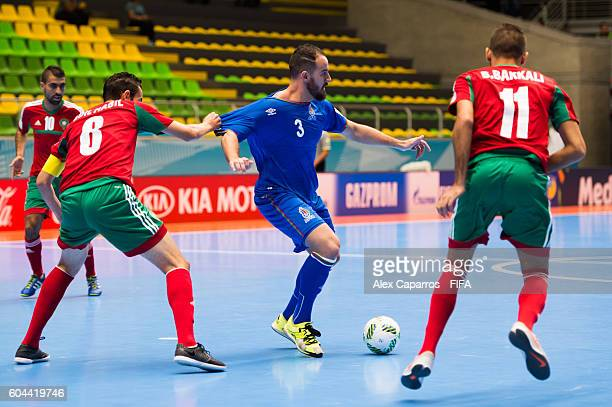 Thiago Bolinha of Azerbaijan plays the ball between Adil Habil and Bilal Bakkali of Morocco during the FIFA Futsal World Cup Group F match between...
