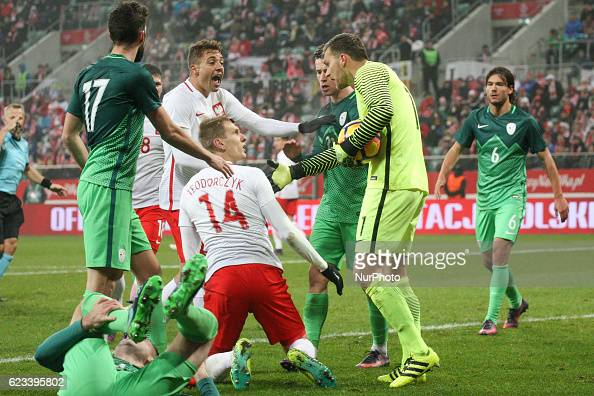 Thiago Cionek and Lukasz Teodorczyk of Polonia Vid Belec of Svovenia during the international friendly football match Poland vs Slovenia on November...