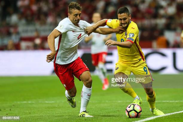Thiago Cionek Florin Andone during the FIFA World Cup 2018 qualification football match between Poland and Romania in Warsaw Poland on June 10 2017
