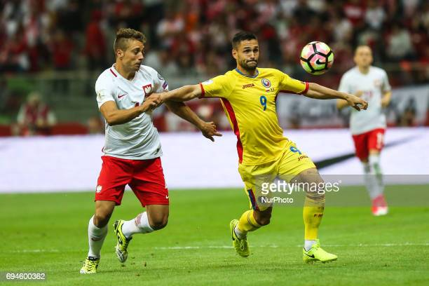 Thiago Cionek Florin Andone vie for the ball during the FIFA World Cup 2018 qualification football match between Poland and Romania in Warsaw Poland...