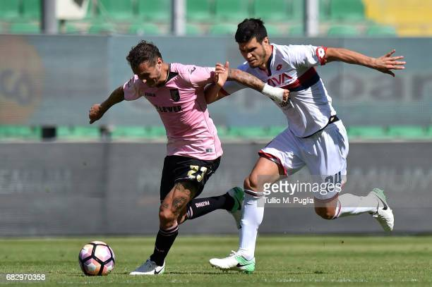 Thiago Cionek of Palermo and Ezequiel Munoz of Palermo compete for the ball during the Serie A match between US Citta di Palermo and Genoa CFC at...