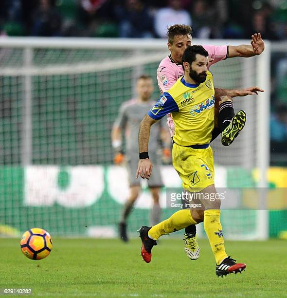 Thiago Cionek of Palermo and Sergio Pellissier of Chievo Verona fight for the ball during the Serie A match between US Citta di Palermo and AC...