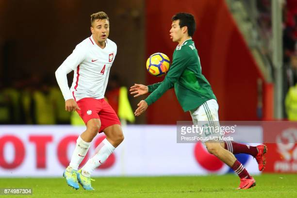 Thiago Cionek of Poland Hirving Lozano of Mexico during the international friendly match between Poland and Mexico on November 13 2017 in Gdansk...