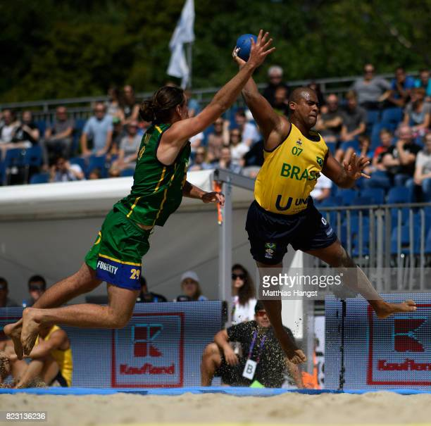 Thiago Claudio of Brazil is challenged by Daniel Fogerty of Australia during the Beach Handball Men's Group B match between Australia and Brazil of...