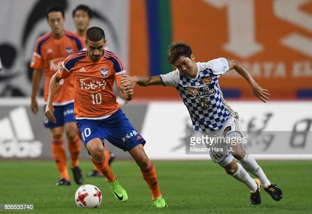 Thiago Galhardo of Albirex Niigata and Hirotaka Mita of Vegalta Sendai compete for the ball during the JLeague J1 match between Albirex Niigata and...