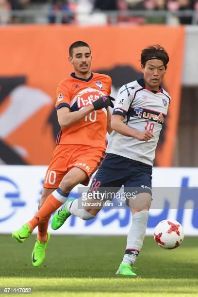 Thiago Galhardo of Albirex Niigata and Keigo Higashi of FC Tokyo compete for the ball during the JLeague J1 match between Albirex Niigata and FC...