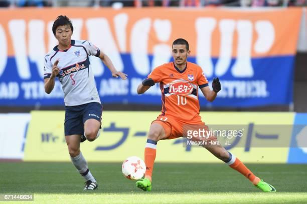 Thiago Galhardo of Albirex Niigata and Yuichi Maruyama of FC Tokyo compete for the ball during the JLeague J1 match between Albirex Niigata and FC...