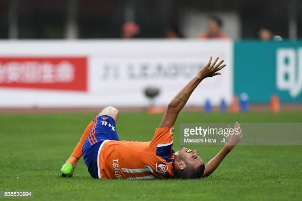 Thiago Galhardo of Albirex Niigata lies injured during the JLeague J1 match between Albirex Niigata and Vegalta Sendai at Denka Big Swan Stadium on...