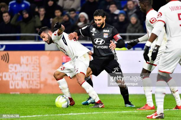 Thiago Maia Alencar of Lille and Nabil Fekir of Lyon during the Ligue 1 match between Olympique Lyonnais and Lille OSC at Parc Olympique on November...
