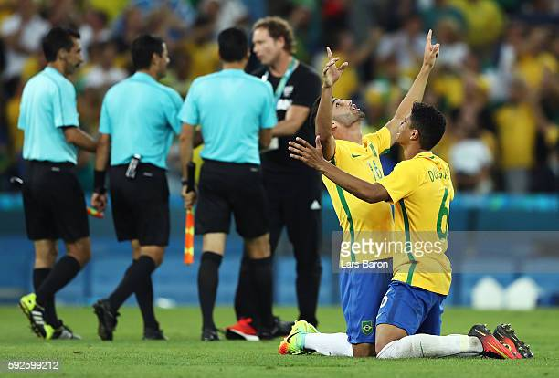 Thiago Maia of Brazil and Douglas Santos of Brazil celebrate winning in the penalty shoot out during the Men's Football Final between Brazil and...