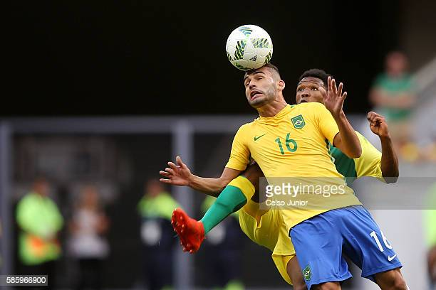 Thiago Maia of Brazil heads the ball against South Africa at Mane Garrincha Stadium on August 4 2016 in Brasilia Brazil