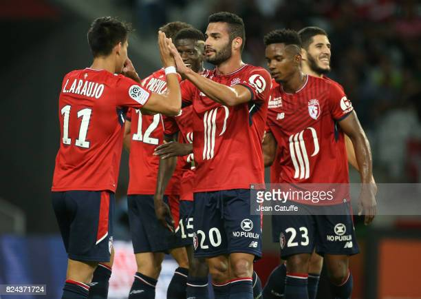 Thiago Maia of Lille celebrates a goal with Luiz Araujo during the preseason friendly match between Lille OSC and Stade Rennais FC at Stade Pierre...