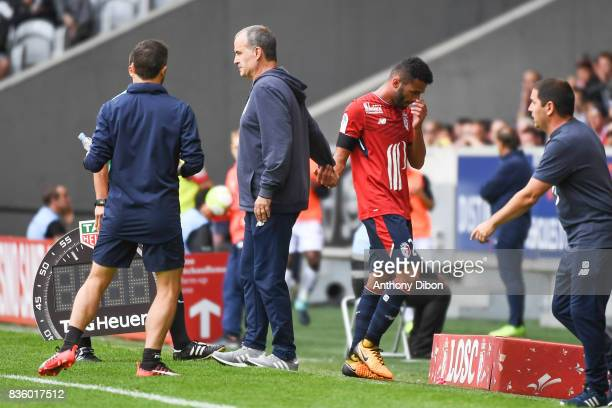THiago Maia of Lille shakes hand with Marcelo Bielsa coach of Lille during the Ligue 1 match between Lille OSC and SM Caen at Stade Pierre Mauroy on...