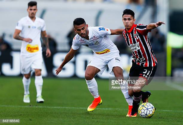 Thiago Maia of Santos and Luiz Araujo of Sao Paulo in action during the match between Santos and Sao Paulo for the Brazilian Series A 2016 at...