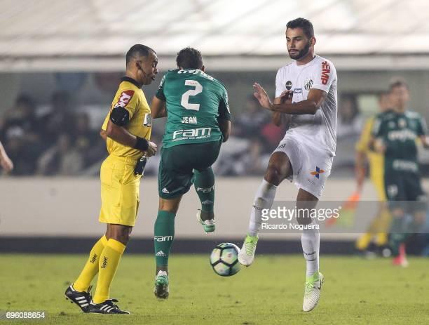 Thiago Maia of Santos battles for the ball with Jean of Palmeiras during the match between Santos and Palmeiras as a part of Campeonato Brasileiro...