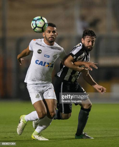 Thiago Maia of Santos battles for the ball with Joao Paulo of Botafogo during the match between Santos and Botafogo as a part of Campeonato...