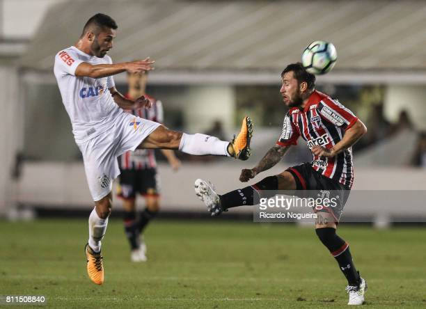 Thiago Maia of Santos battles for the ball with Jonathan Gomez of Sao Paulo during the match between Santos and Sao Paulo as a part of Campeonato...